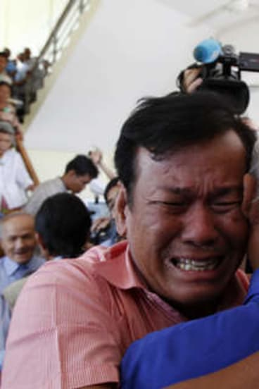 Cambodian former Khmer Rouge survivors, Soum Rithy, left, and Chum Mey.