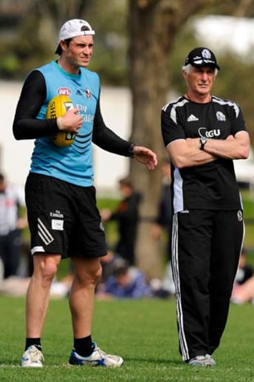 Leigh Brown with coach Mick Malthouse.