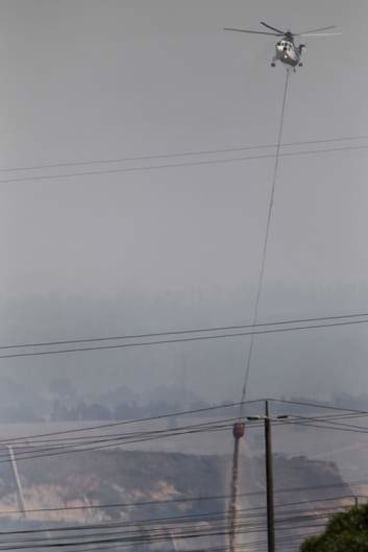 Fire fight: Helicopters waterbomb the Hazelwood mine blaze.
