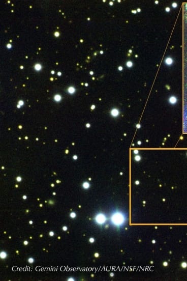A composite image of the field around FRB 121102. The dwarf galaxy from which the fast radio bursts originate is a barely visible green dot.