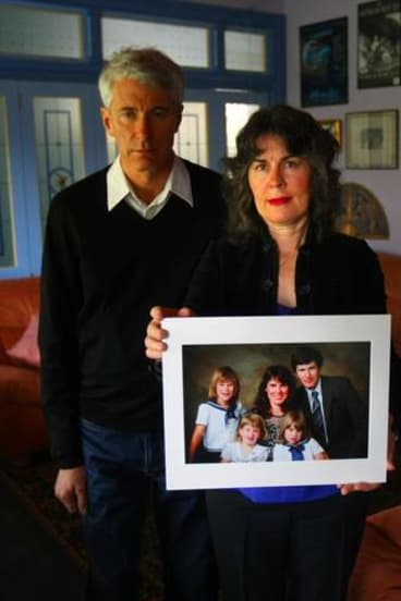 Anthony and Chrissie Foster with a family picture showing their two daughters Emma (back left) and Katie (front right) who were raped by Father Kevin O'Donnell.