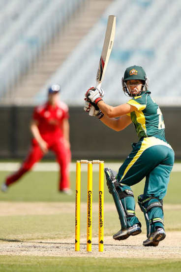 More runs: Nicole Bolton on her way to a century at the MCG.