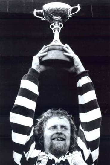 Laurie Fisher  holds the John I Dent Trophy aloft after ANU beat Royals in the 1992 ACT Rugby Union grand final.