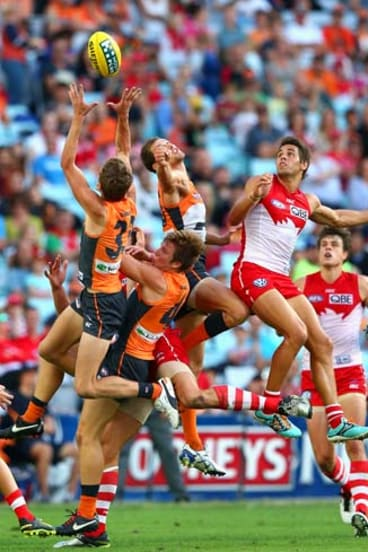 Giant mark: GWS youngster Will Hoskin-Elliott takes a fine grab against the Swans on Saturday.