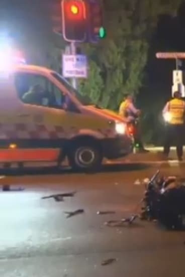 Two motorists were killed after a motorbike sped through a red light in Lane Cove on Saturday morning.