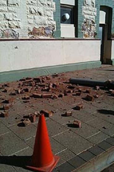 Bricks litter the streets of Boulder.