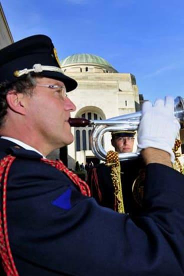 Buglers from Belgium, Filip Top (left) and Jan Callemein, play the Last Post at the Australian War Memorial.