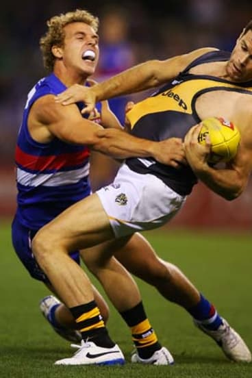 Captain courageous: Trent Cotchin takes a one-handed mark against Bulldog Mitch Wallis.