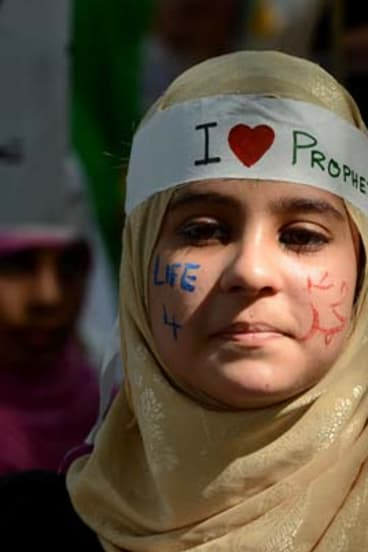 """Protest rally ... a young Pakistani woman, her face adorned with the words """"Life 4 Holy Prophet Mohammed"""" takes part in a demonstration in Islamabad on Saturday."""