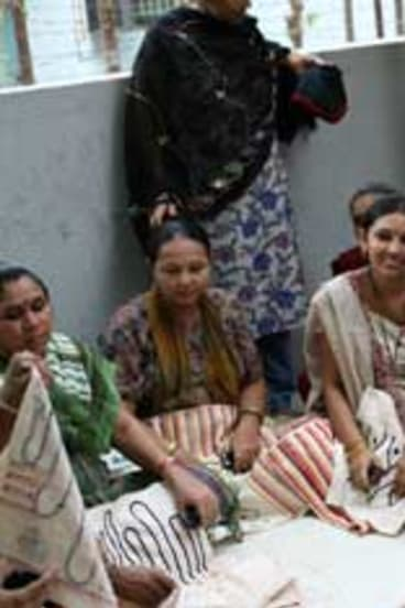 Surrogate mothers at the Akanksha clinic with their embroidery.