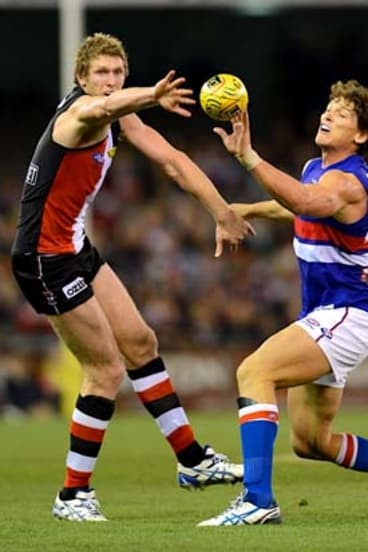 Up for grabs: St Kilda's Ben McEvoy (left) and Bulldog Will Minson vie for the ball at Etihad Stadium.