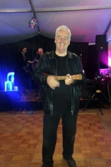 Tim Keeble inviting National Folk Festival patrons to the new blackboard venue The Pod.