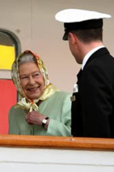 Britain's Queen Elizabeth II talks with Captain Michael Hepburn, after boarding the yacht 'Hebridean Princess' in Stornoway, Scotland.