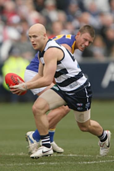 Gary Ablett, of the Cats, runs the ball out of defence against the West Coast Eagles at Skilled Stadium.