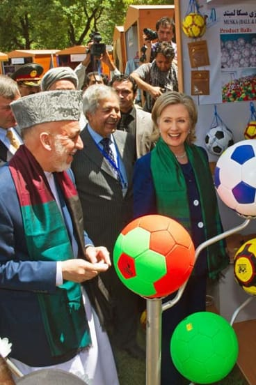 Afgan President Hamid Karzai and US Secretary of State Hillary Clinton  tour a crafts baazar in Kabul, where they are attending the International Conference on Afghanistan.