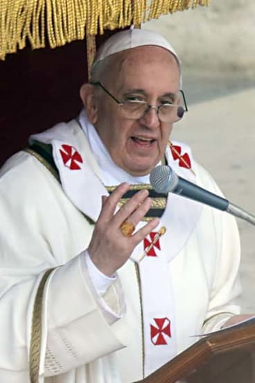 """""""We must open his arms to protect all of God's people"""": Pope Francis."""