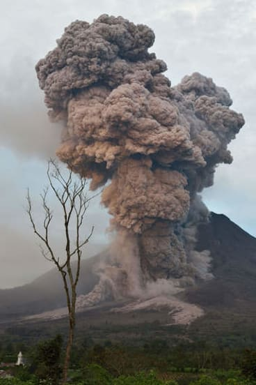 Sinabung spews ash into the air during an eruption.