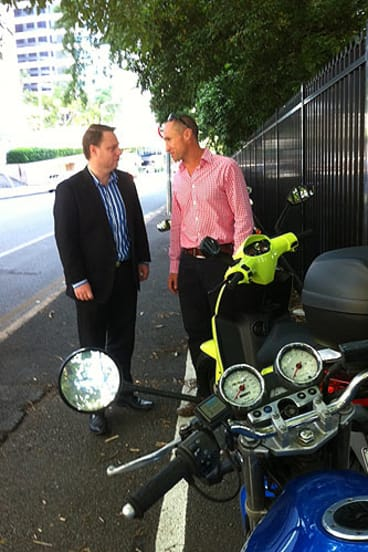 Paul Peterson from the motorcycle division of the MTAQ talks to Deputy Mayor Adrian Schrinner about extra motorcycle and scooter spaces.