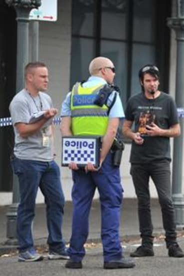Police outside the house in North Carlton where the body of Greg Ham was found yesterday.