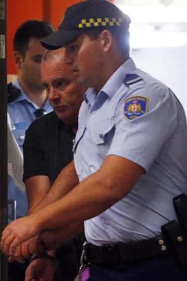Arrested over the alleged murder of Mr Gao: Glen McNamara is escorted from Kogarah local court.