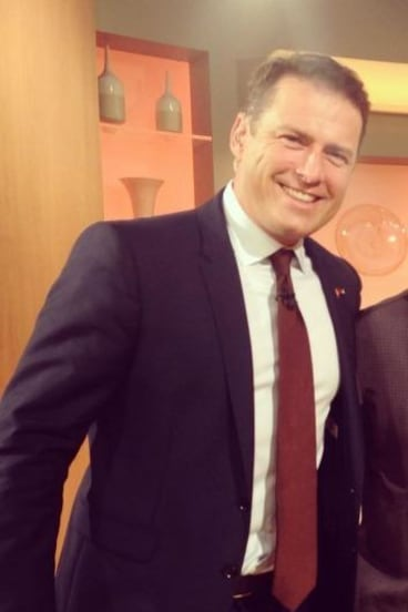 The fame game: Karl Stefanovic in the 'little bit stanky' suit he intends to auction.