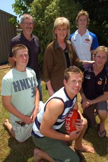 Selwood family [November 25, 2006] - left to right - Joel Selwood, Bryce, Maree, Troy Selwood & Scott Selwood.  Adam at front with footy.