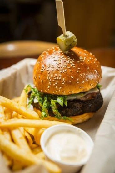 Ready to eat: The 250gm Wagyu Burger at the Boathouse Restaurant by the Maribyrnong River.