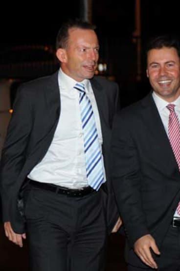 Optimism ... Josh Frydenberg, pictured right with Tony Abbott.