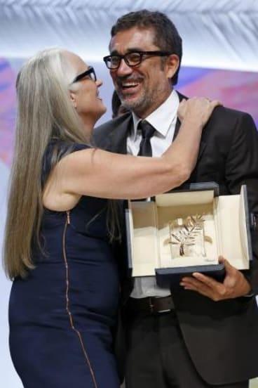Cannes jury president Jane Campion kisses director Nuri Bilge Ceylan, Palme d'Or award winner for his film 'Winter Sleep'.
