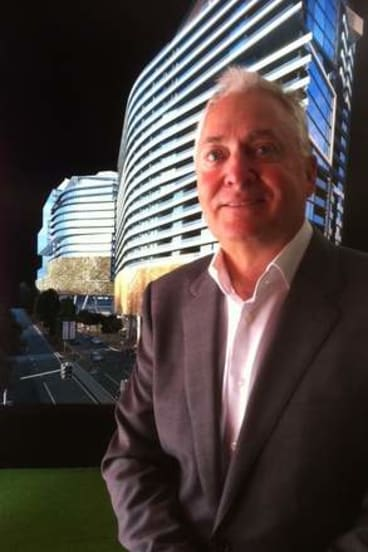Architect and developer Tony John, from the Anthony John Group in front of an artists impression of his company's Southpoint development at South Bank.