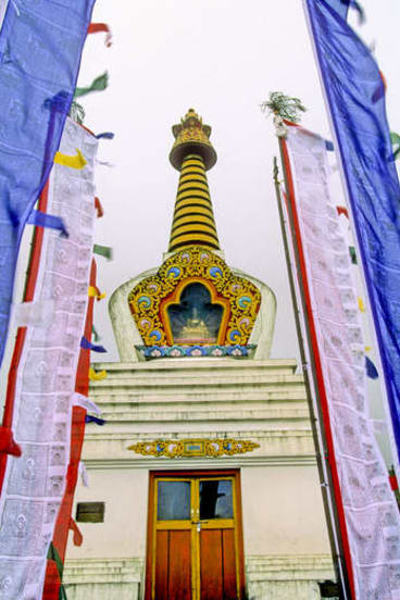 To the heavens … a Buddhist temple surrounded by prayer flags.