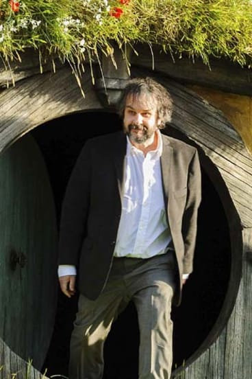 Directing magic ... Peter Jackson emerges from a 'Hobbit Hole'.