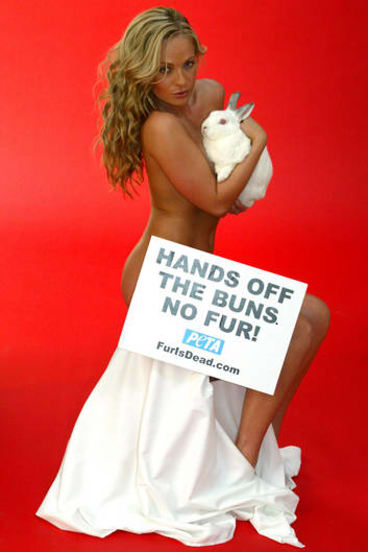 """A naked Imogen Bailey pose with """"Reggie"""" the rabbit during an anti-fur photo shoot for Peta in Sydney March 25, 2004."""