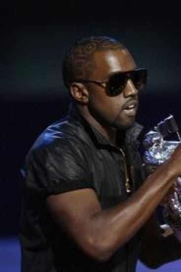 Kanye West takes the microphone from best female video winner Taylor Swift in 2009.