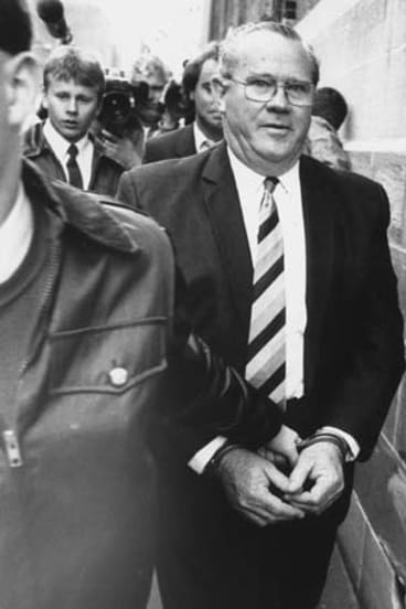 Jackson being led into court in handcuffs in 1987.