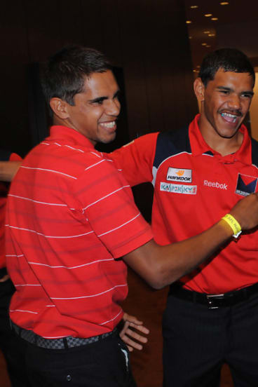 Lewis Jetta  who was drafted by Swans, is congratulated by first cousin Neville (from Melbourne).