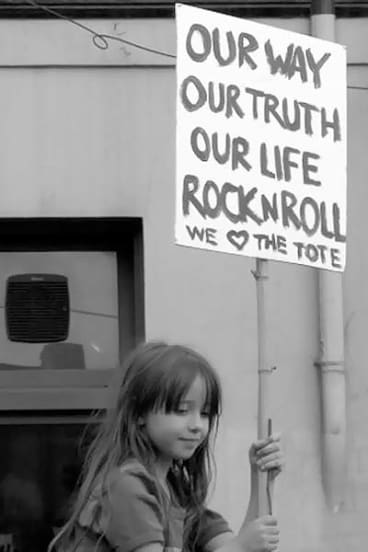 A young supporter of the Tote  protesting the pub's closure.
