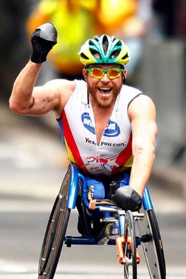 London, here I come … Kurt Fearnley celebrates his victory.