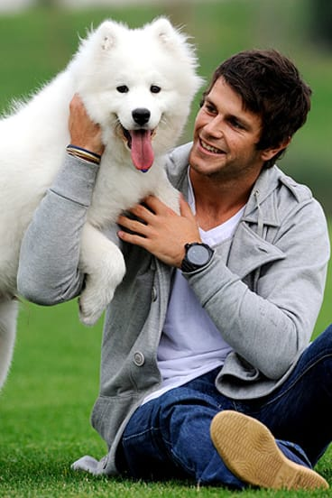 Trent Cotchin with his samoyed puppy, Kuda.
