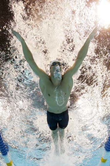 Phelps swims to victory.