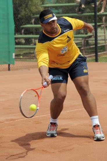 Scott Sio shows his tennis skills.