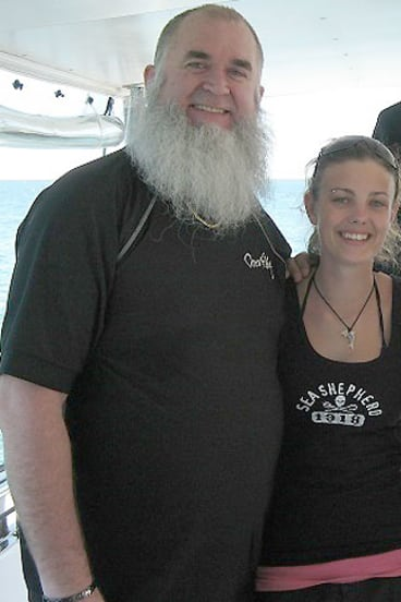 Elyse Frankcom, shortly after her first time back in the water after the attack, with Trevor Burns, the man who helped save her.
