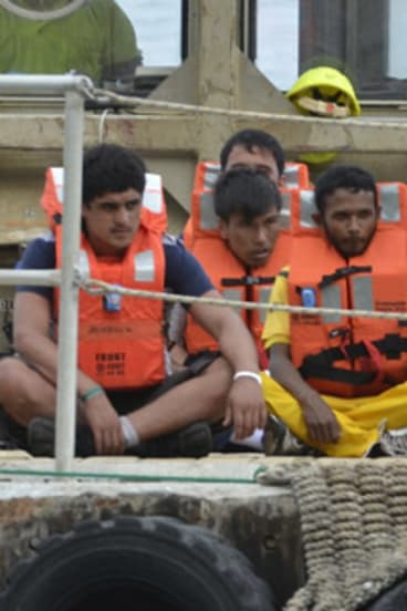 A group of asylum seekers arrive on Christmas Island.