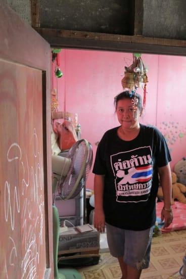 Former prostitute Lek in her home in Klong Toey slum.