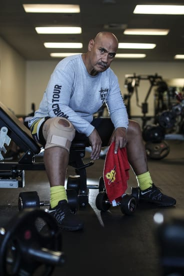 Flight attendant Fuzzy Maiava was slammed into the aircraft's ceiling during the nosedives. He relies on visits to the gym to cope with his physical and psychological injuries.