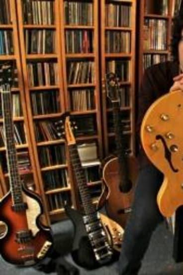 Musician Davey Lane amongst his vast collection of Beatles memorabilia.