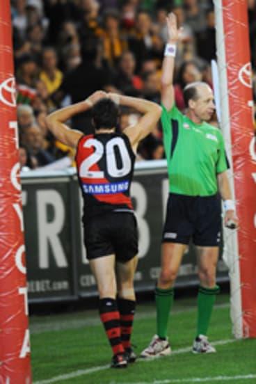 Umpire Scott McLaren pays the controversial free kick.