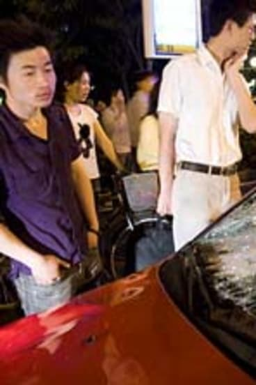 After the accident ... Hu Bin's car is photographed in the streets of Hangzhou after the collision.