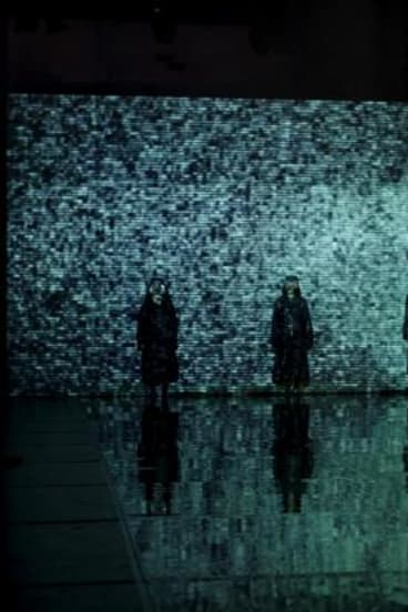 The innovative production design makes effective use of projections.