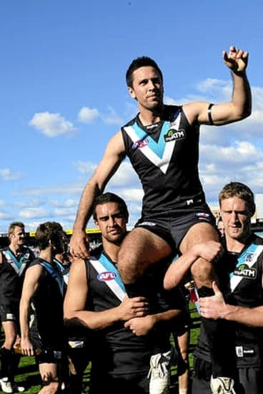 Troy Chaplin, pictured celebrating his 100th game in 2010, could be off to Richmond.
